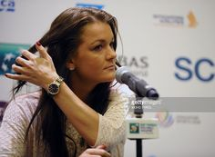 Tennis player Agnieszka Radwanska of Poland speaks during a press conference prior to the WTA Finals in Singapore on October 24, 2015. AFP PHOTO / Mohd Fyrol