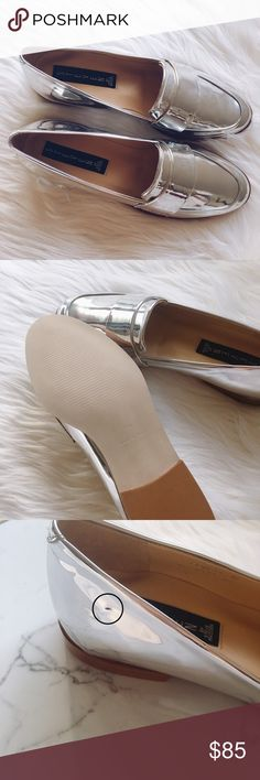 "Steven by Steve Madden • silver loafer flat Slip-on loafer with almond toe with 0.75"" stacked heel. Fit is narrow and sizing runs slightly small. Please see photos #3-4 for minor imperfection on left side. Not noticeable when worn but it looks like a small crease when seen up close. Otherwise, in new condition! Steven by Steve Madden Shoes Flats & Loafers"