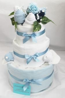 3 tier baby nappy cake with clothes to look like flowers/celebration cake