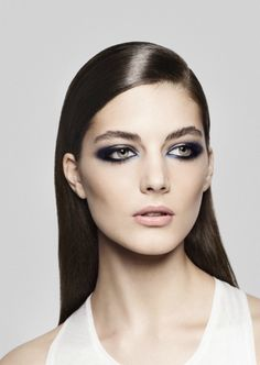 Smooth Operator: A powerful eye look, like this glittery smokey eye, would be too much if paired with a 'do that looks overdone. Smooth and straight hair is all you need for a polished look. (via And Other Stories)