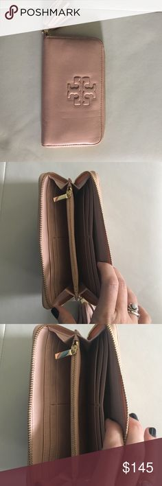 Tory Burch Thea Continental Wallet *SOLD OUT* Love this wallet and color though have another TB that I use daily. Only used this once! Not worn on any level, like new! Tory Burch Bags Wallets