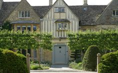 Look at those pleached crab apple trees!  What an entrance! Renovated garden for a manor house in Oxfordshire - Arne Maynard Garden Design