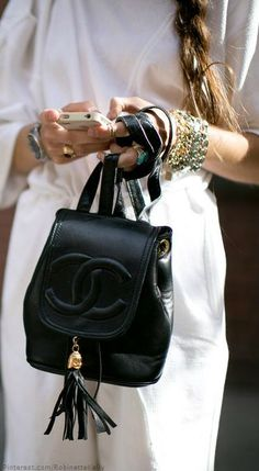 ced700416a8 When you re toting a tasseled Chanel backpack, you can keep the rest simple
