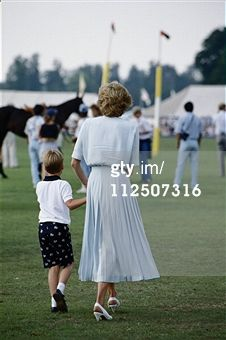 Prince William with his mother, Diana, Princess of Wales (1961-1997), with their backs to the camera, attending the Cartier International Polo Day, held at Smiths Lawn Polo Club in Windsor, Berkshire, England, Great Britain, 23 July 1989. (Photo by Tim Graham/Getty Images)