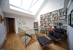 New pitched roof with large roof light increases volume of the house and allows the morning sun to fill the space below.