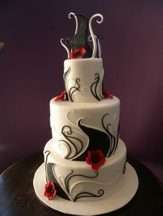 My groom's favorite design so far - modern, not floral, and incorporates black/white/cranberry colors