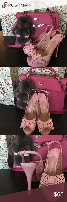 Italy 🇮🇹 Made Baby Pink Perforated Bow Heels. Italy 🇮🇹 Made Baby Pink Bow perforated Platform Heels Sz 37.5 Euro/ Sz 7 US. So cute, brand new without tag, never been worn. Bottom sole has some scratches, please see last pictures for more details. Shoes