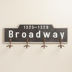 One of my favorite discoveries at WorldMarket.com: Broadway Wood 4-Hook Wall Storage