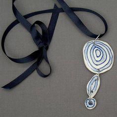 ovals | Blue & white porcelain pendant. | Mick Marineau & Barb Jensen | Flickr