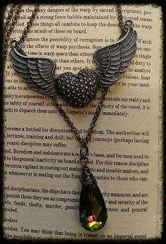 Flying heart necklace by CraftypumpkinJewels on Etsy