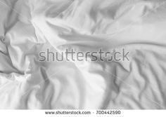 Top view of white bedding sheets after wake up in the morning