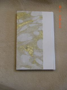 Back side of blank journal with white leather spine and Thai marbled paper and hand sewn headbands. Made by Roxanne