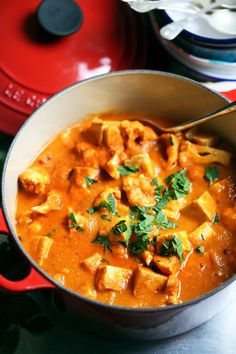 An easy vegan Indian vegetable korma recipe with tofu, cauliflower, coconut, and warming spices. Healthy and easy.