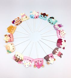 The listing for 16 Num Noms cupcake toppers that are laminated. Perfect addition for the Num Noms fan! Approximately 2 tall/wide and each come on a 4  popsicle stick.   Check out my Num Noms necklaces: https://www.etsy.com/listing/462191159/num-noms-necklaces-15-party-favors-gifts?ga_order=most_relevant&ga_search_type=all&ga_view_type=gallery&ga_search_query=num%20nom&ref=sr_gallery_11  Check out my Num Noms rings and hair ties…