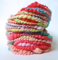 Saltwater Taffy Handspun Art Yarn, Coily Ply. https://www.etsy.com/listing/130340909/saltwater-taffy-handspun-art-yarn-coily, via Etsy.
