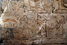 A tomb dating back to around 1,100BC with a remarkable painting of a funerary procession (pictured) and the afterlife has been uncovered. Here, the guard's three sons make offerings to their seated parents. Paser's title can be read and a monkey (top left) perhaps indicates that the guard was married - although it could be a pet...