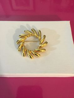 Gold Tone pin Wheel Brooch by Monet