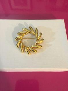 Gold Tone pin Wheel Brooch by Monet