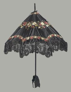 Large black satin parasol embroidered with polychrome silks, red and white predominating, in three horizontal bands of flowers, black machine made lace ruffle around e … Victorian Era, Victorian Fashion, Vintage Fashion, Victorian Costume, Victorian Ladies, Classic Fashion, Gothic Fashion, Fashion Fashion, Gail Carriger
