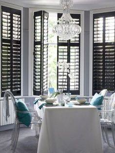 These Black plantation shutters in this dining room look very dramatic and gorgeous
