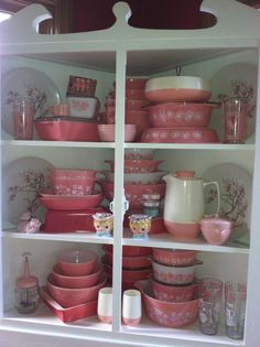 Corner cupboard of Pyrex 'Gooseberry, 'Pink' and 'Flamingo'.