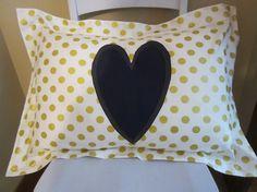 a modern gold and navy pillow sham