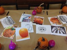 Spread out ideas on the pumpkin carving table to get those jack-o-lantern juices flowing.