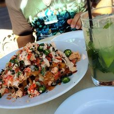 Lobster nachos and a mojito! You can find this from the Cove Bar at California Adventures! 10/29/15  #lobsternachos #covebar #disney #disneyland #californiaadventure #disneyland60 #arielsgrotto by allysdisneyfood