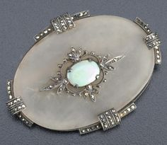Theodor Fahrner matte rock crystal brooch of silver with marcasites, and an opal cabochon, oval quatrefoil design, ca. 1928.