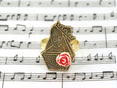 Queen of Hearts Alice in Wonderland Ring Jewelry - Brass with Resin Rose by fripparie from fripparie. Visit http://ift.tt/1o0ATec for more awesome steampunk fantasy and goth jewelry and accessories.