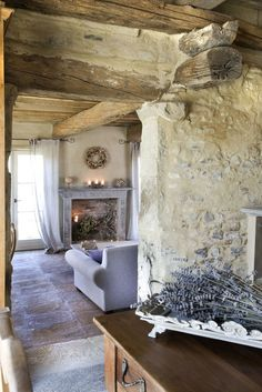 Charming limestone weathered walls and rough hewn beams in French farmhouse living room with French lavender. French Farmhouse Decor Inspiration Ideas will take you on a romantic tour of images capturing this charming decor style. French Farmhouse Decor, French Country Living Room, French Country Cottage, French Country Style, French Decor, French Country Decorating, Cottage Style, Farmhouse Interior, Country Farmhouse