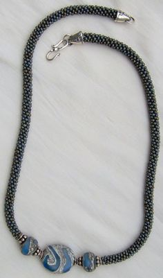 This project looks a lot like a crocheted rope, but instead of taking days to make it will only take a few hours. It is made on a Japanese Marudai braiding table. You will learn both how to set up the Marudai and how to do the actual braiding. Making the Kumihimo necklace is so very fast that you will no doubt want to make lots of them. Learning this technique and the use of the Marudai will then allow you to continue with many more advanced projects.