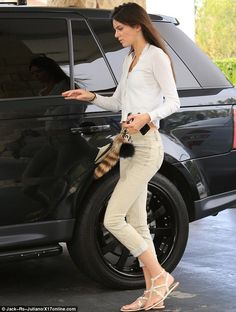 In a rush: Kendall  swiftly hopped back into her car after the job was done