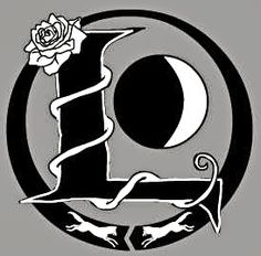 """I was going for a simple design that both related to the books and kept its distance. Some of the smaller details to notice: The pointed edges of the """"L"""" are supposed to imply """"thorns."""" The outermost black ring is the """"cycle"""" symbol, representing the moon cycle and the cycle of Lunar royalty.  The waxing crescent moon is probably my most story-related aspect, because I like to think that Cinder is the growing light, taking back the dark moon."""