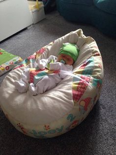 Baby Joey lies in pure comfort on his Personalised Baby Shower Gift - Patchwork Animal Gaga Baby Bean Bag!