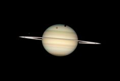 Quadruple Saturn Moon Transit: Hubble snapped this pic of four of Saturn's moons (Titan, Mimas, Dione, and Enceladus) transiting the planetary disk in 2009.