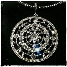 Estate Art Deco Circle Crystal Pendant Necklace Very intricate estate art deco style circle crystal pendant necklace. The necklace is approximately 18inch and a very unique fancy link. Ajustable. The pendant is studded with crystals and measures about 3 inches wide. Very substantial showy piece. Unsigned Silver plated. Found in a Boca Raton estate sale. Very good quality items to be had at this sale. This was one of the finds. Vintage  Jewelry Necklaces