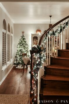 stair garland with lights: gorgeous Christmas lights at night in these 25+ home tours #christmasnightstour #holidayhometour #christmaslights