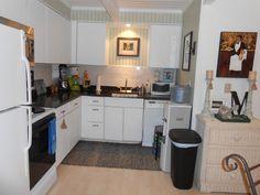 Cottage Kitchen- White Cabinets - Ubatuba granite countertops