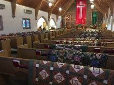 Today I attended a funeral for a quilter. Her family decided to hang all of the quilts she had made over the back of each pew. It was breathtaking! : quilting