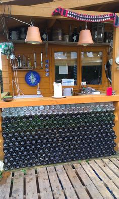 Wall for bar from empty wine bottles