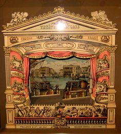 A Victorian paper theater... a model for the exterior of a digital video.