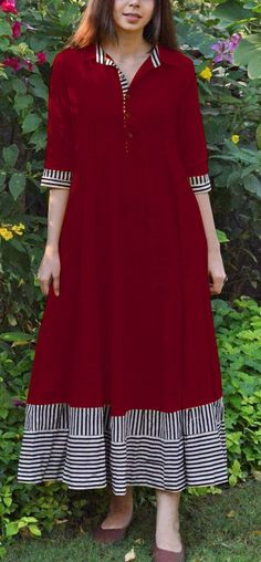 Apr 2020 - IK Mango slice Maroon Color: Maroon Fabrics: Top :- Slubby Cotton Stitch Type: Fully-StitchedTop Length: Up to inchesFlaire :- 3 MeterSize: Long Kurta Designs, Printed Kurti Designs, Kurta Designs Women, Cotton Dress Indian, Cotton Gowns, Cotton Long Dress, Casual Cotton Dress, Latest Gown Styles, Velvet Dress Designs