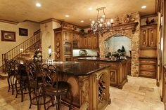 37726 Edgewater Drive Pinehurst, TX 77362: Photo No expense was spared in this kitchen, with granite counter tops, extensive moldings, mill work, Dacor gas cook top and stainless steel appliances. This spacious island kitchen is a delight for any master chef.
