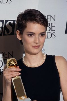 """Nonie accepting her award for """"Sexiest Woman Alive."""" Or is it """"Best Boy's Haircut On A Woman?"""" Or maybe """"Biggest Natural Breasts In Hollywood?"""" They're all good! (Especially that last one.) ♥♥♥♥♥"""