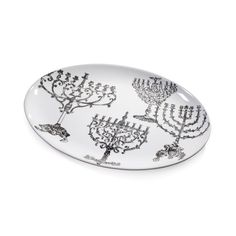 The Jewish Museum Lights of Hanukkah Platter features images of menorahs from the Museum's collection.  Comes in a beautiful gift box.