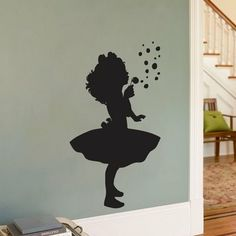This silhouette, used as a stencil to create framed art with scrapbook paper!