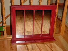 Old window-painted red-with mirror and shelf