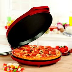 """The Mini Pizza Maker features nonstick cooking plates to make a 12"""" pizza in mere minutes. Just turn on the power, wait for the indicator light, and prepare for deliciousness. The easy clean up is a yummy bonus."""