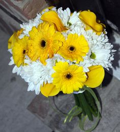 """No roses"" were the brides instructions.  Yellow and white wedding flowers with daisies, gerber daisies and yellow calla lilies."